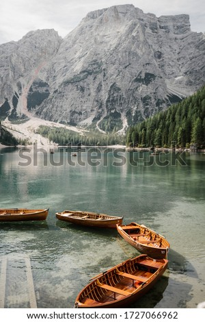 Natural landscapes of the mountain lake Braies in the Dolomites, Italy. Boats on the mountain lake Braies (Lake Pragser Wildsee) in Sudtirol. The mountains. Linked boats on a mountain lake