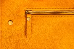 Natural leather texture. Macro photo. Fragment of a pink bag made of genuine leather. Bag design element. Bovine leather texture. Bovine skin.