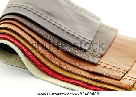 Natural leather upholstery samples with stitching in various colors