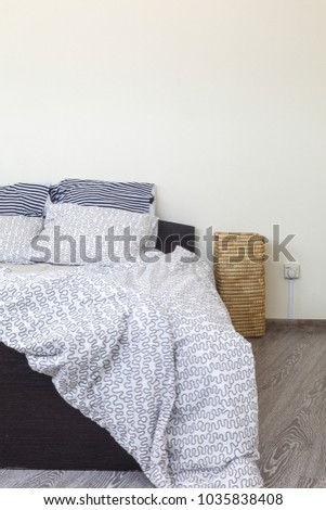 natural light morning bedroom interior, bedclothes unclean, bright and cozy, minimalistic design #1035838408