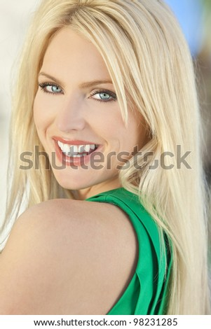 Natural light portrait of a happy smiling beautiful blond woman with blue eyes