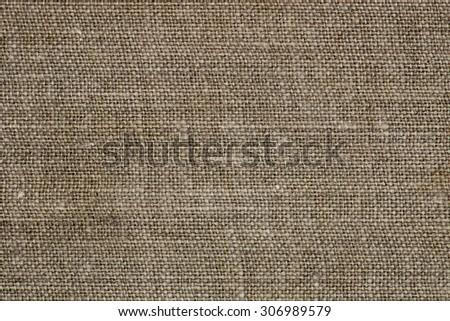 Natural linen texture closeup photo background.