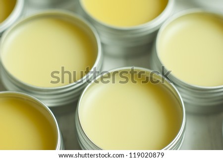 natural lip balms from beeswax in tin pots