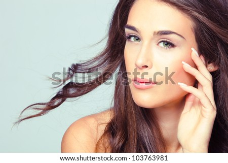 natural looking green eye young woman beauty portrait, studio shot, brunette, long hair