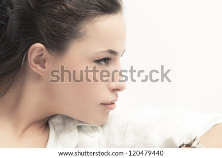 natural looking young woman portrait studio shot profile