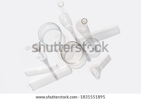 Natural medicine, cosmetic research, bio science, organic skin care products. Top view, flat lay. Skincare. Scientific laboratory glassware. Research and development Concept.