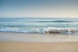 Natural minimalist seascape environment. Golden sandy beach on Tarifa coast