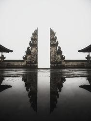 Natural mirror reflection of famous gate balinese gateway to heaven at Pura Penataran Agung Lempuyang temple in Bali Indonesia South East Asia