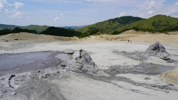 Natural mud volcano inside a geothermal area