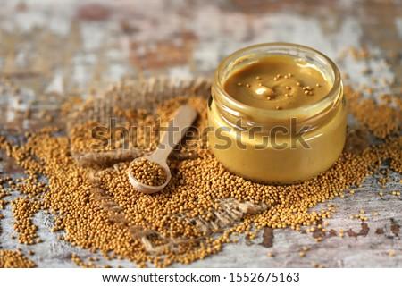 Natural mustard in a jar. Grains of mustard. Homemade mustard. Organic mustard. Selective focus. Macro. Сток-фото ©