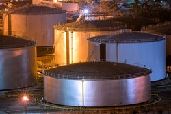 Natural Oil and Gas storage tanks and in Petrochemical industrial plant at night