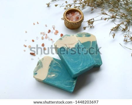 Natural oil soap and himalayan pink salt on white table, cold process.