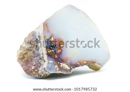Natural opal stone polished on a white background