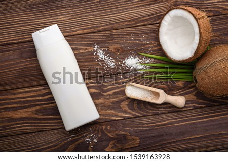 natural organic cosmetic. No label bottle with cosmetic and cream, fresh open coconut for skincare, #1539163928