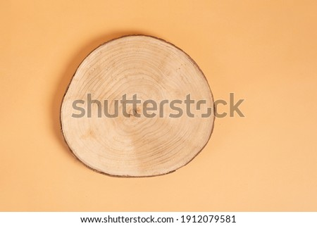 Natural organic eco-friendly beauty product concept. Wooden cross section cut on beige background. Showcase for cosmetic products. Top view, mockup. Product advertisement. wood slice