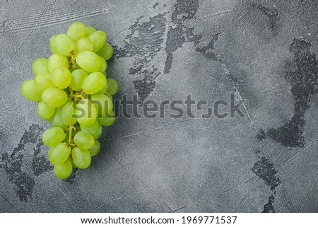 Natural organic juicy grapes set, green fruits, on gray stone background, top view flat lay, with copy space for text Foto stock ©