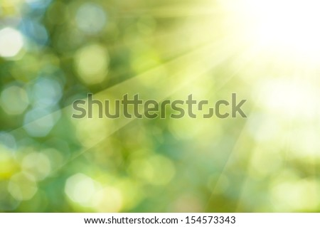 Natural outdoors bokeh background  in green and yellow tones with sun rays #154573343