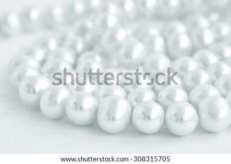 stock-photo-natural-pearl-necklace-on-wh