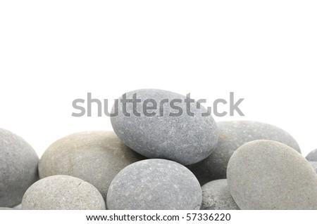 Natural piles of sea pebbles - stock photo