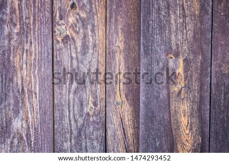 Natural planking, lumber, old boards. Unpainted surface. Wide vertical stripes. Toning.