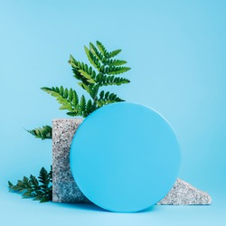 Natural podium showcase with frame, bracken leaf and ball sphere on vibrant blue background. Concept scene stage for product, promotion, sale, presentation or cosmetic. Minimal empty mock up template.
