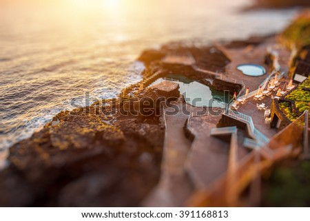 Natural pools in Charco Azul resort on La Palma island on the sunrise in Spain. Tilt-shift effect - stock photo