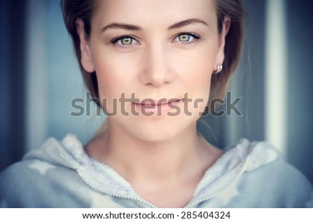 Natural portrait of a beautiful woman, authentic beauty of Caucasian female face, lite makeup on perfect skin and green eyes, genuine natural looking girl