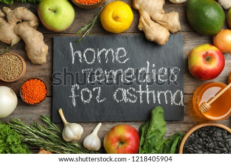 Natural products and slate board with text HOME REMEDIES FOR ASTHMA on wooden background, flat lay #1218405904