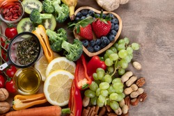 Natural products rich in antioxidants and vitamins. Healthy clean and detox food - vegetables, fruits, nuts, superfoods