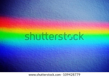 Natural rainbow light on concrete yellow painted wall background.