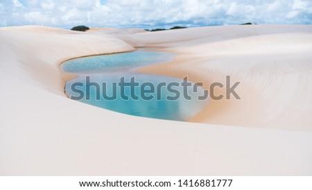 Natural rainwater pool in Lencois Maranhenses National Park, Maranhao, Brazil white sand dunes desert with blue and green lagoons. Remote holiday idyllic destination. #1416881777
