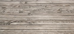 Natural reclaimed wood surface with aged boards. Wooden planks on a wall or floor with grain and texture. Neutral flat vintage wood background.