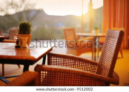 Natural restaurant interior with scenic view at sunset