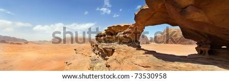natural rock bridge and panoramic view of Wadi Rum desert, Jordan