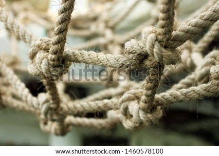 Natural rope tied to one another for stronger bonds. Bond at the end of the rope. Team work and leader concept. Natural rope pattern texture background.
