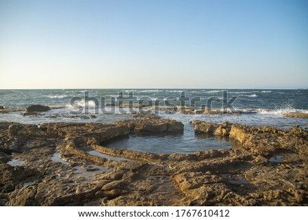 Natural round hole in the riffs of Mediterranean sea Stock foto ©