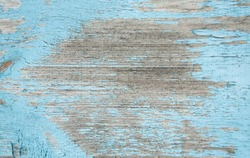 Natural Rustic Old Wood Board Wall Shabby Blue Color Background. Wooden Vintage Style Texture. Wood Surface Panel with Peeling Paint Close up. Horizontal Image Copy Space