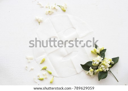 natural sheet mask for face from flower on background white