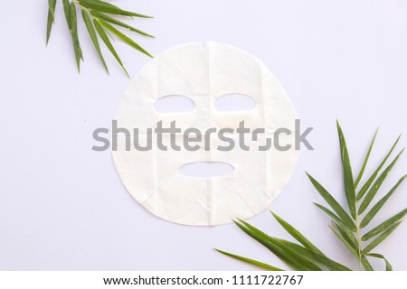 natural sheet mask for skin face from herbal bamboo on background white