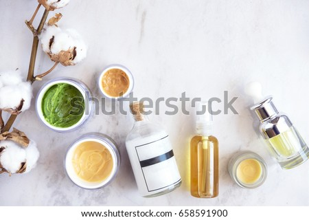 Natural skincare cosmetic products on white marble table from above. Creams, balms, masks, oils, serums.   Beauty blogger concept #658591900