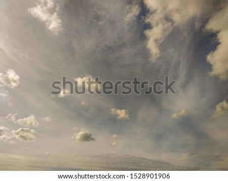 Natural sky with clouds. Beautiful abstract sky like a picture. Image of the sky with clouds created by nature. Windy day in the sky.