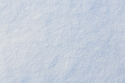 Natural snow texture. Smooth surface of clean fresh snow. Snowy ground. Winter background with snow patterns. Perfect for Christmas and New Year design. Closeup top view.
