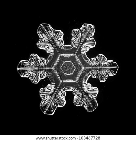 natural snowflake isolated on a black background