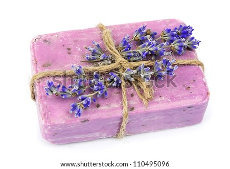 Natural soap and lavender flowers on a white background