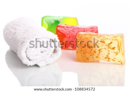 Natural soap and towel over white background - stock photo