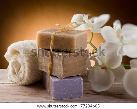 natural soap with towel and flower