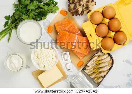 Natural sources of vitamin D and Calcium. Healthy food background. Top view. Space for text #529742842