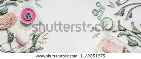 Natural spa, wellness or skin care composition with water bowl , flowers, green leaves, towel and accessories for home  cellulite treatment on white background, top view, banner. Beauty and health