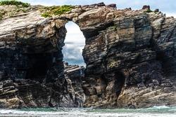 Natural stone arches of the Catedrales beach in Ribadeo, Lugo, Galicia (Playa de Aguas Santas)