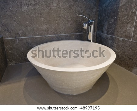 natural stone designer hand wash basin with chrome tap over